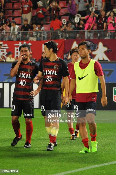 Mitsuo Ogasawara Mu Kanazaki and Atsutaka Nakamura of Kashima Antlers react after their 20 victory in the JLeague J1 match between Kashima Antlers...