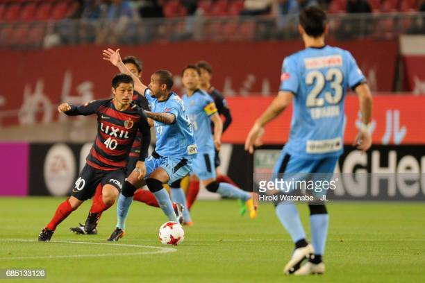 Mitsuo Ogasawara of Kashima Antlers and Eduardo Neto of Kawasaki Frontale compete for the ball during the JLeague J1 match between Kashima Antlers...
