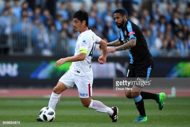 Mitsuo Ogasawara of Kashima Antlers and Eduardo Neto of Kawasaki Frontale compete for the ball during the JLeague J1 match between Kawasaki Frontale...