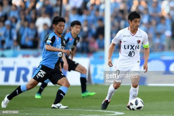 Mitsuo Ogasawara of Kashima Antlers and Hidemasa Morita of Kawasaki Frontale compete for the ball during the JLeague J1 match between Kawasaki...