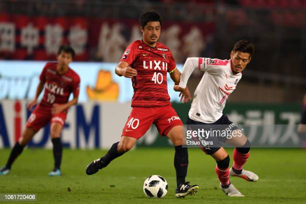 Mitsuo Ogasawara of Kashima Antlers and Hotaru Yamaguchi of Cerezo Osaka compete for the ball during the J.League J1 match between Kashima Antlers...