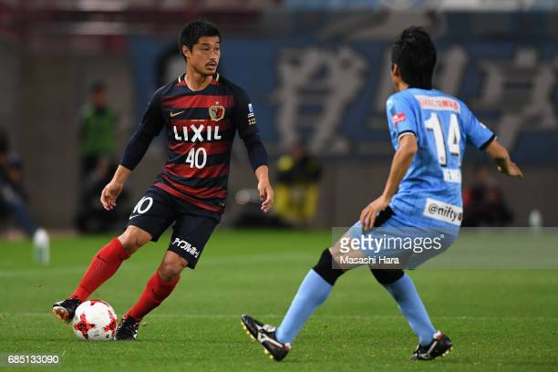 Mitsuo Ogasawara of Kashima Antlers and Kengo Nakamura of Kawasaki Frontale compete for the ball during the JLeague J1 match between Kashima Antlers...
