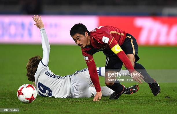 Mitsuo Ogasawara of Kashima Antlers and Luka Modric of Real Madrid in action during the FIFA Club World Cup Final match between Real Madrid and...