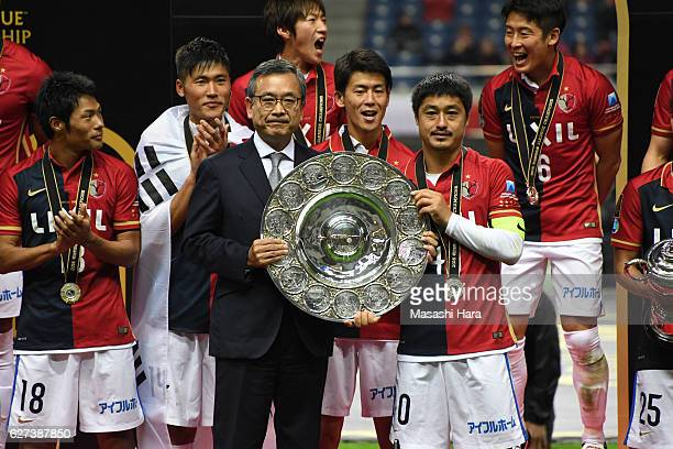 Mitsuo Ogasawara of Kashima Antlers and Mitsuru Murai look on after winning the J.League Championship Final second leg match between Urawa Red...