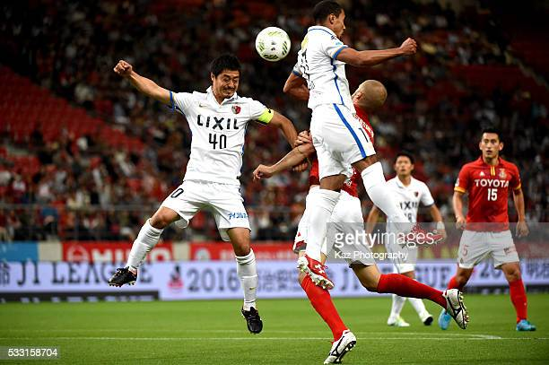 Mitsuo Ogasawara of Kashima Antlers and Simovic of Nagoya Grampus compete for the ball during the JLeague match between Nagoya Grampus and Kashima...