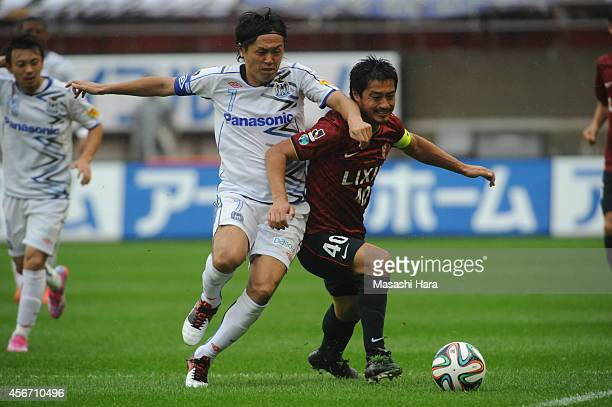 Mitsuo Ogasawara of Kashima Antlers and Yasuhito Endo of Gamba Osaka compete for the ball during the JLeague match between Kashima Antlers and Gamba...