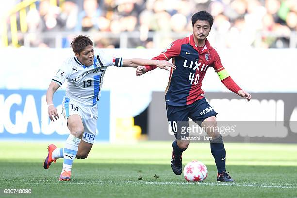 Mitsuo Ogasawara of Kashima Antlers and Yoshito Okubo of Kawasaki Frontale compete for the ball during the 96th Emperor's Cup final match between...