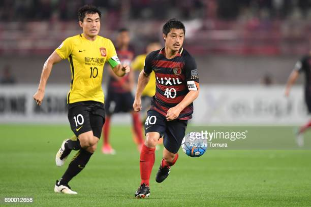 Mitsuo Ogasawara of Kashima Antlers celebrates runs with the ball during the AFC Champions League Round of 16 match between Kashima Antlers and...