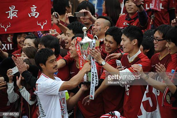 Mitsuo Ogasawara of Kashima Antlers celebrates the victory with supporters after the JLeague Yamazaki Nabisco Cup final match between Kashima Antlers...
