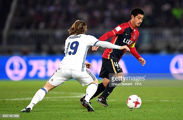 Mitsuo Ogasawara of Kashima Antlers is closed down by Luka Modric of Real Madrid during the FIFA Club World Cup Final match between Real Madrid and...