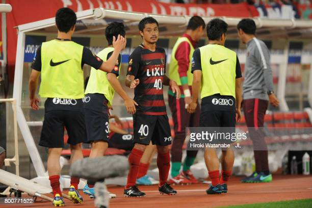 Mitsuo Ogasawara of Kashima Antlers shakes hands with his team mates after substituted during the JLeague J1 match between Kashima Antlers and...