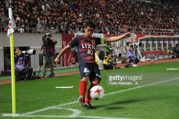 Mitsuo Ogasawara of Kashima Antlers takes a corner kick during the JLeague J1 match between Kashima Antlers and Consadole Sapporo at Kashima Soccer...