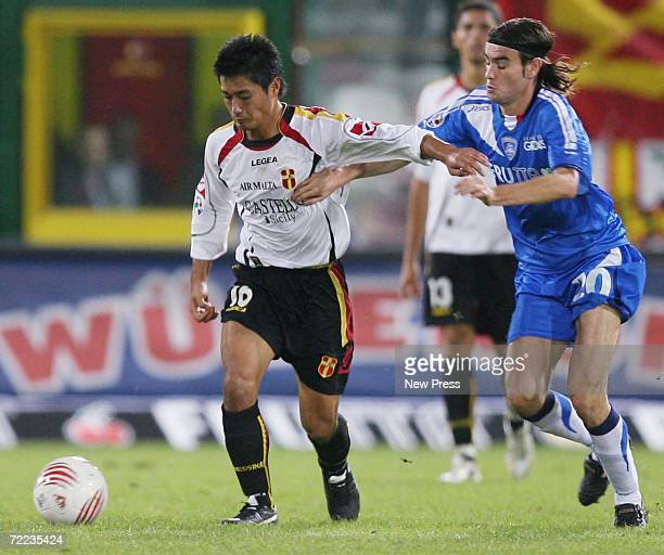 Mitsuo Ogasawara of Messina is challenged by Daniele Buzzegoli of Empoli during the Serie A match between Messina and AC Milan at the Stadio Giovanni...