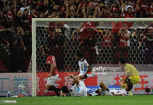 Mitsuru Nagata of Urawa Red Diamonds scores the second goal during the J.League match between Urawa Red Diamonds and Kawasaki Frontale at Saitama...