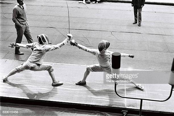 Mitsuyuki Funamizu of Japan and Tran Van Xuan of Vietnam compete in the Fencing Men's Sabre individual round one during the Tokyo Summer Olympic...