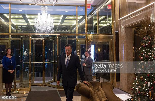 Mitt Romney arrives to speak with the media after meeting with US Presidentelect Donald Trump at Trump International Hotel and Tower Tuesday November...