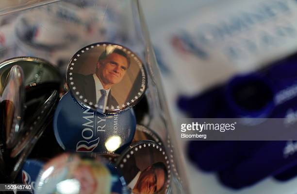 Mitt Romney buttons are displayed for sale at the Republican National Convention in Tampa Florida US on Wednesday Aug 29 2012 Representative Paul...