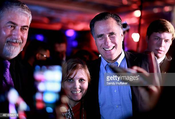 Mitt Romney greets fellow Republicans at a dinner during the Republican National Committee's Annual Winter Meeting aboard the USS Midway on January...