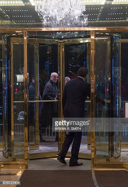 Mitt Romney leaves after speaking to the media following his meeting with US Presidentelect Donald Trump at Trump International Hotel and Tower...