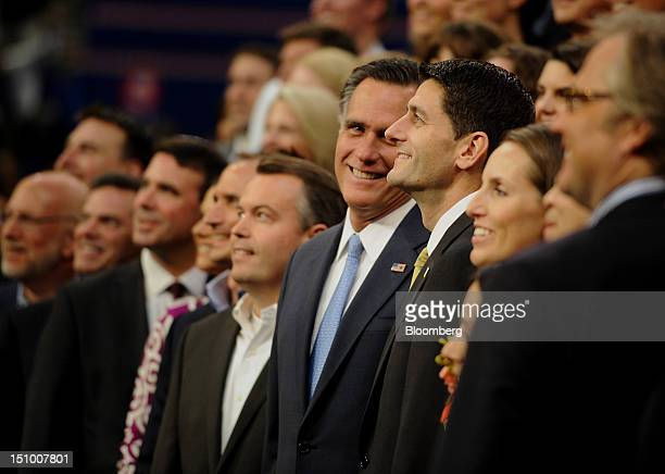 Mitt Romney Republican presidential candidate center and Representative Paul Ryan vice presidential candidate center right smile during a group photo...