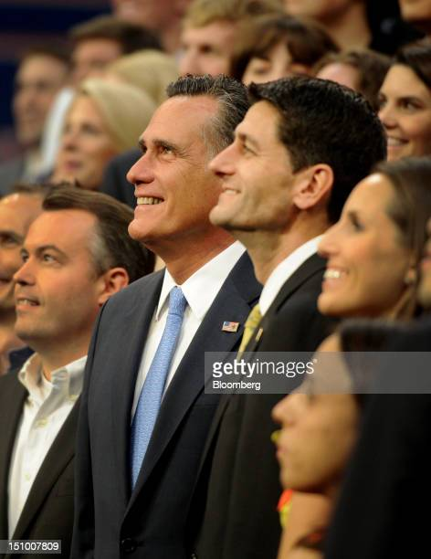 Mitt Romney Republican presidential candidate center and Representative Paul Ryan vice presidential candidate right smile during a group photo at the...