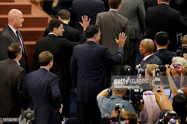 Mitt Romney Republican presidential candidate center and Representative Paul Ryan vice presidential candidate left wave during a walk through at the...