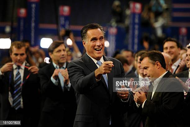 Mitt Romney Republican presidential candidate center gestures during a walk through at the Republican National Convention in Tampa Florida US on...