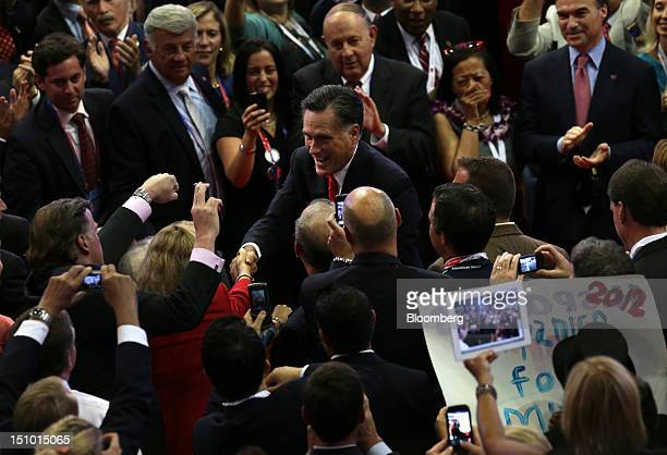 Mitt Romney Republican presidential candidate center greets delegates before taking the stage to speak at the Republican National Convention in Tampa...