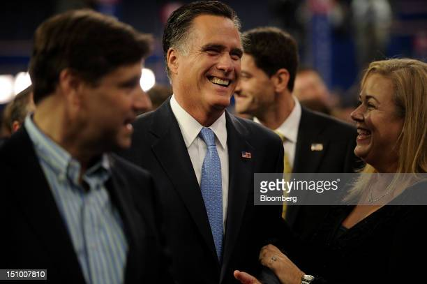 Mitt Romney Republican presidential candidate center laughs during a walk through at the Republican National Convention in Tampa Florida US on...