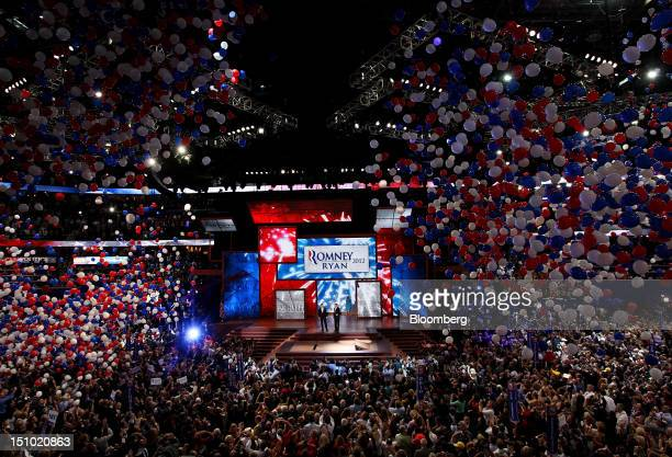 Mitt Romney Republican presidential candidate center right and Representative Paul Ryan vice presidential candidate stand on stage while balloons...