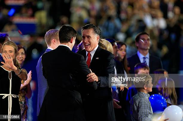 Mitt Romney Republican presidential candidate center right embraces Representative Paul Ryan vice presidential candidate after speaking at the...
