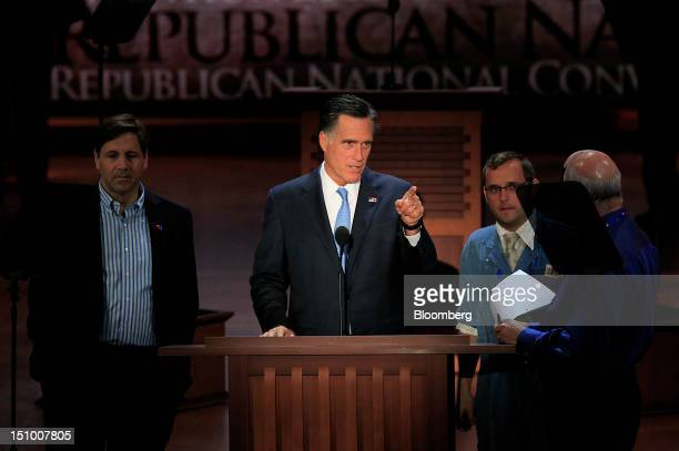 Mitt Romney Republican presidential candidate center speaks at the Republican National Convention in Tampa Florida US on Thursday Aug 30 2012 Romney...