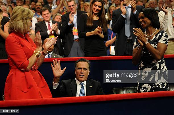 Mitt Romney Republican presidential candidate center waves while wife Ann Romney left and Condoleezza Rice former US secretary of state applaud as...