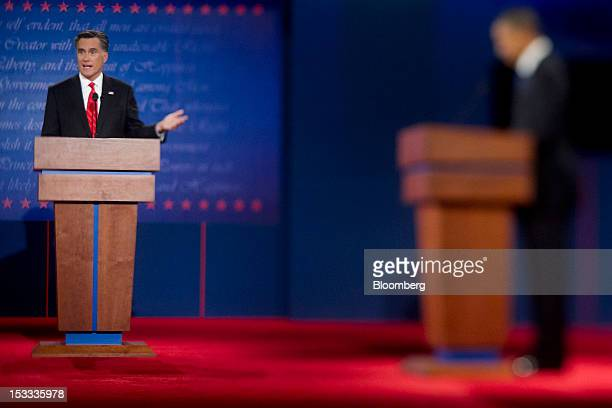 Mitt Romney Republican presidential candidate left and US President Barack Obama participate in a presidential debate in this photo taken with a tilt...