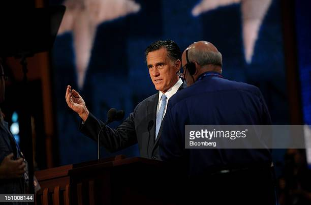 Mitt Romney Republican presidential candidate left gestures during a sound check at the Republican National Convention in Tampa Florida US on...