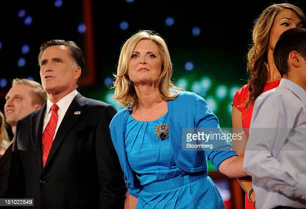 Mitt Romney Republican presidential candidate left stands on stage with wife Ann Romney center at the Republican National Convention in Tampa Florida...