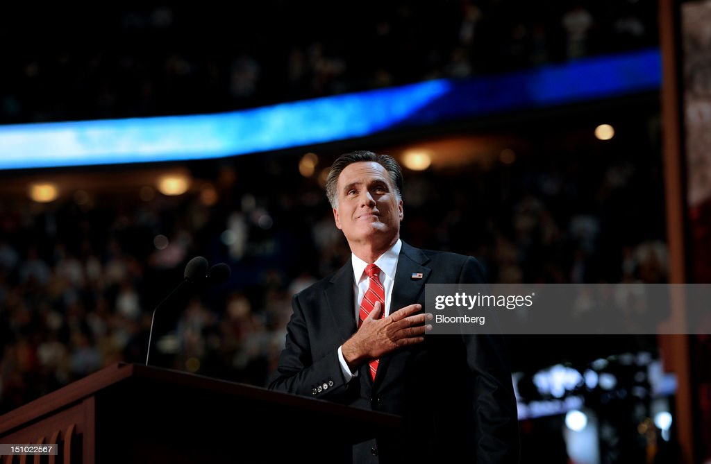 Mitt Romney, Republican presidential candidate, pauses before speaking at the Republican National Convention (RNC) in Tampa, Florida, U.S., on Thursday, Aug. 30, 2012. Romney, a wealthy former business executive who served as Massachusetts governor and as a bishop in the Mormon church, is under pressure to show undecided voters more personality and emotion in his convention speech tonight, even as fiscal conservatives in his own party say he must more clearly define his plans for reining in the deficit and improving the economy. Photographer: Daniel Acker/Bloomberg via Getty Images