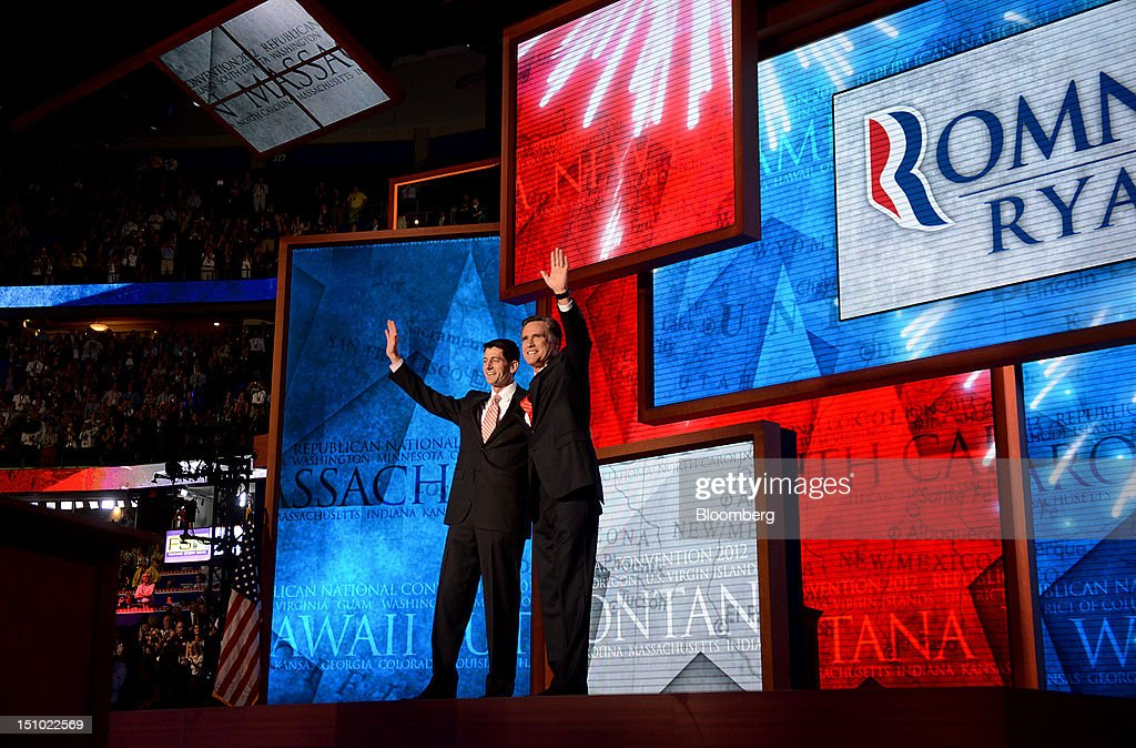 Mitt Romney, Republican presidential candidate, right, and Representative Paul Ryan, vice presidential candidate, wave on stage at the Republican National Convention (RNC) in Tampa, Florida, U.S., on Thursday, Aug. 30, 2012. Mitt Romney, a wealthy former business executive who served as Massachusetts governor and as a bishop in the Mormon church, is under pressure to show undecided voters more personality and emotion in his convention speech tonight, even as fiscal conservatives in his own party say he must more clearly define his plans for reining in the deficit and improving the economy. Photographer: Daniel Acker/Bloomberg via Getty Images