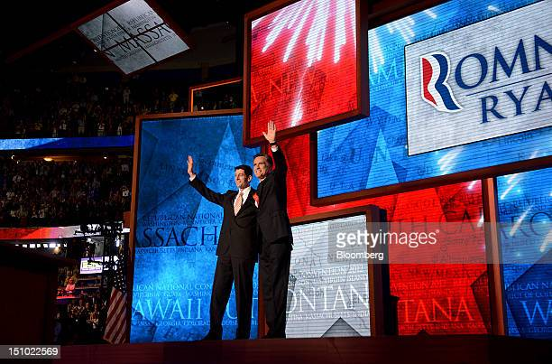 Mitt Romney Republican presidential candidate right and Representative Paul Ryan vice presidential candidate wave on stage at the Republican National...