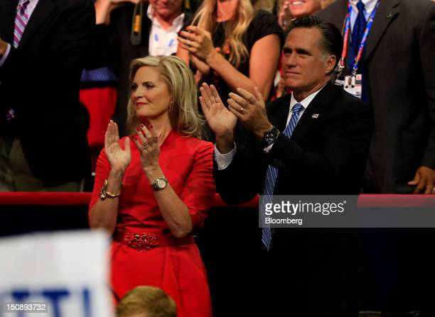 Mitt Romney Republican presidential candidate right and wife Ann Romney applaud while Chris Christie governor of New Jersey unseen speaks at the...