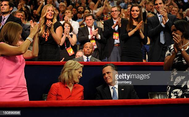 Mitt Romney Republican presidential candidate second right and wife Ann Romney second left sit while Condoleezza Rice former US secretary of state...