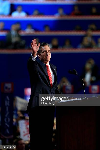 Mitt Romney Republican presidential candidate waves after taking the stage to speak at the Republican National Convention in Tampa Florida US on...