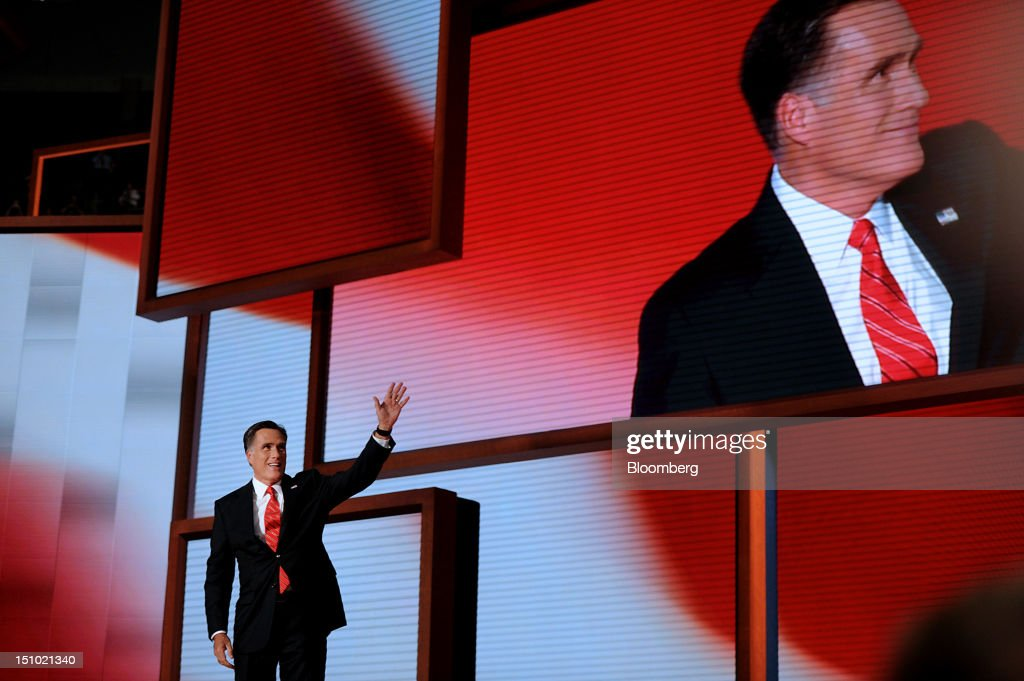 Mitt Romney, Republican presidential candidate, waves before speaking at the Republican National Convention (RNC) in Tampa, Florida, U.S., on Thursday, Aug. 30, 2012. Romney, a wealthy former business executive who served as Massachusetts governor and as a bishop in the Mormon church, is under pressure to show undecided voters more personality and emotion in his convention speech tonight, even as fiscal conservatives in his own party say he must more clearly define his plans for reining in the deficit and improving the economy. Photographer: Daniel Acker/Bloomberg via Getty Images