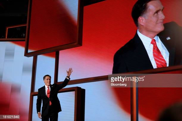 Mitt Romney Republican presidential candidate waves before speaking at the Republican National Convention in Tampa Florida US on Thursday Aug 30 2012...