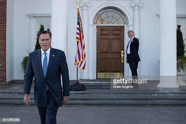 Mitt Romney walks to speak to the press as Presidentelect Donald Trump gives the thumbs up after their meeting at Trump International Golf Club...