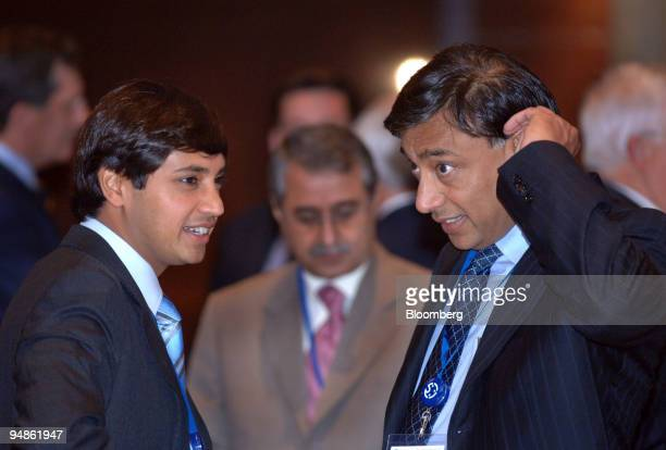 Mittal Steel Chairman CEO Lakshmi N Mittal right chats with his son President CFO Aditya Mittal during a coffee break at the International Iron and...