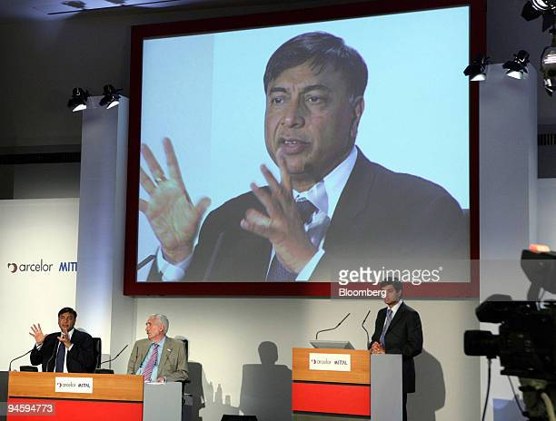 Mittal Steel Co Chairman Lakshmi Mittal on screen and left speaks while Arcelor Chairman of the Board of Directors Joseph Kinsch center and Mittal...