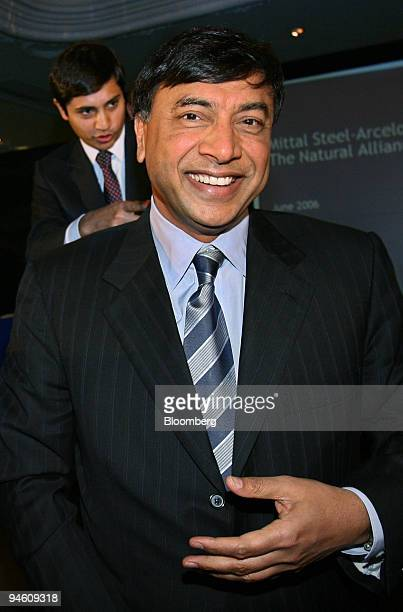 Mittal Steel Co Chairman Lakshmi Mittal smiles as he leaves a news conference in London June 13 2006 Mittal Steel Co trying to buy rival Arcelor SA...