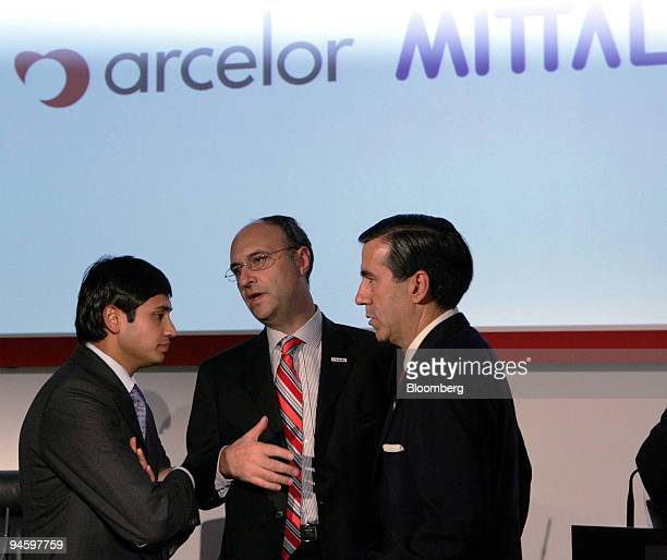 Mittal Steel Co President and Chief Financial Officer Aditya Mittal left speaks to Arcelor Deputy Chief Executive Officer Michel Wurth center and...
