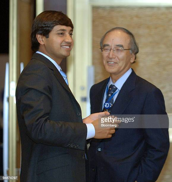 Mittal Steel President CFO Aditya Mittal left chats with Nippon Steel Corp President Akio Mimura right during a coffee break at the International...